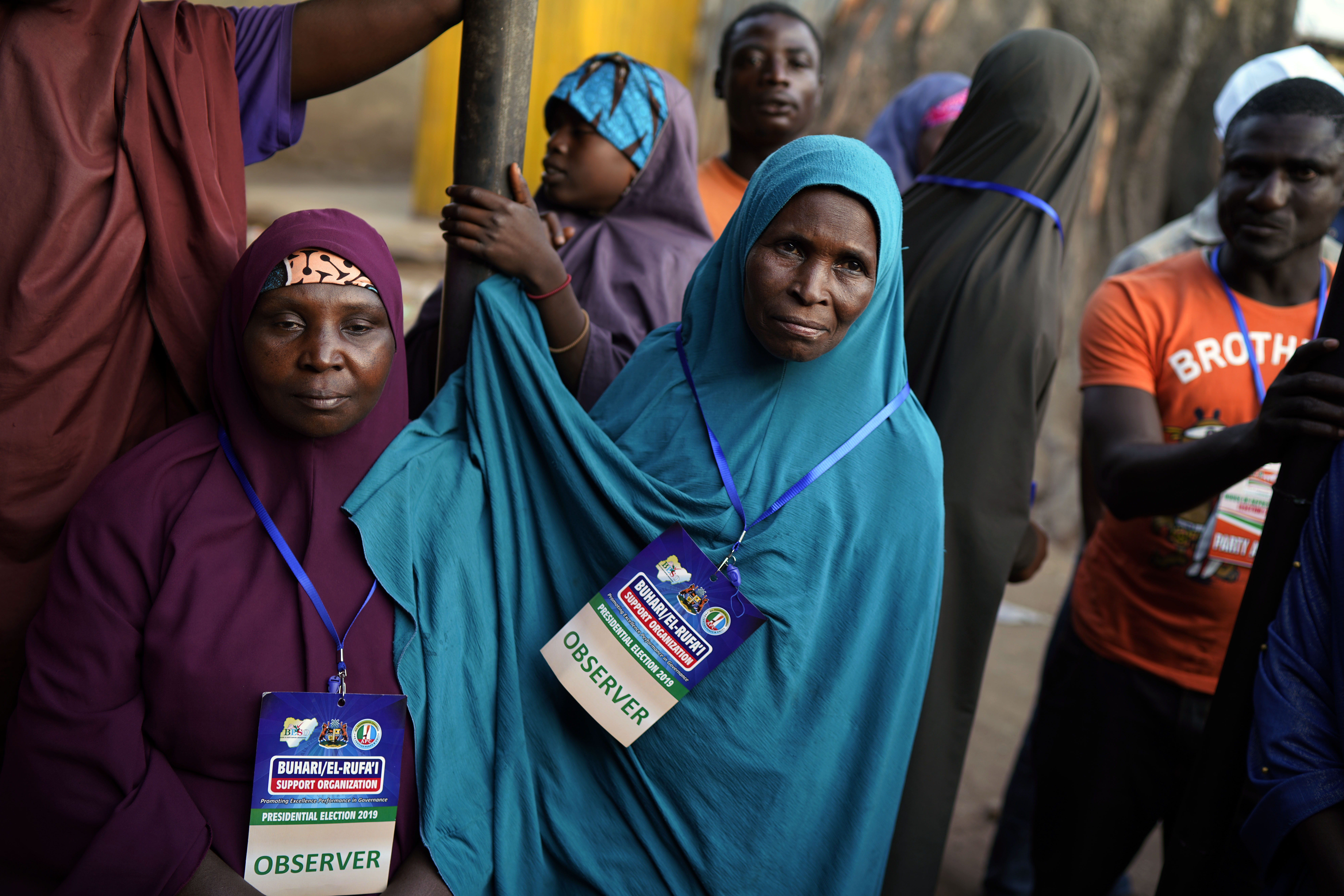 Nigerian election observers watch votes being counted in Kaduna, Nigeria, Saturday Feb. 23, 2019. Incumbent President Muhammadu Buhari is facing opposition presidential candidate Atiku Abubakar in the presidential election. (AP Photo/Jerome Delay)