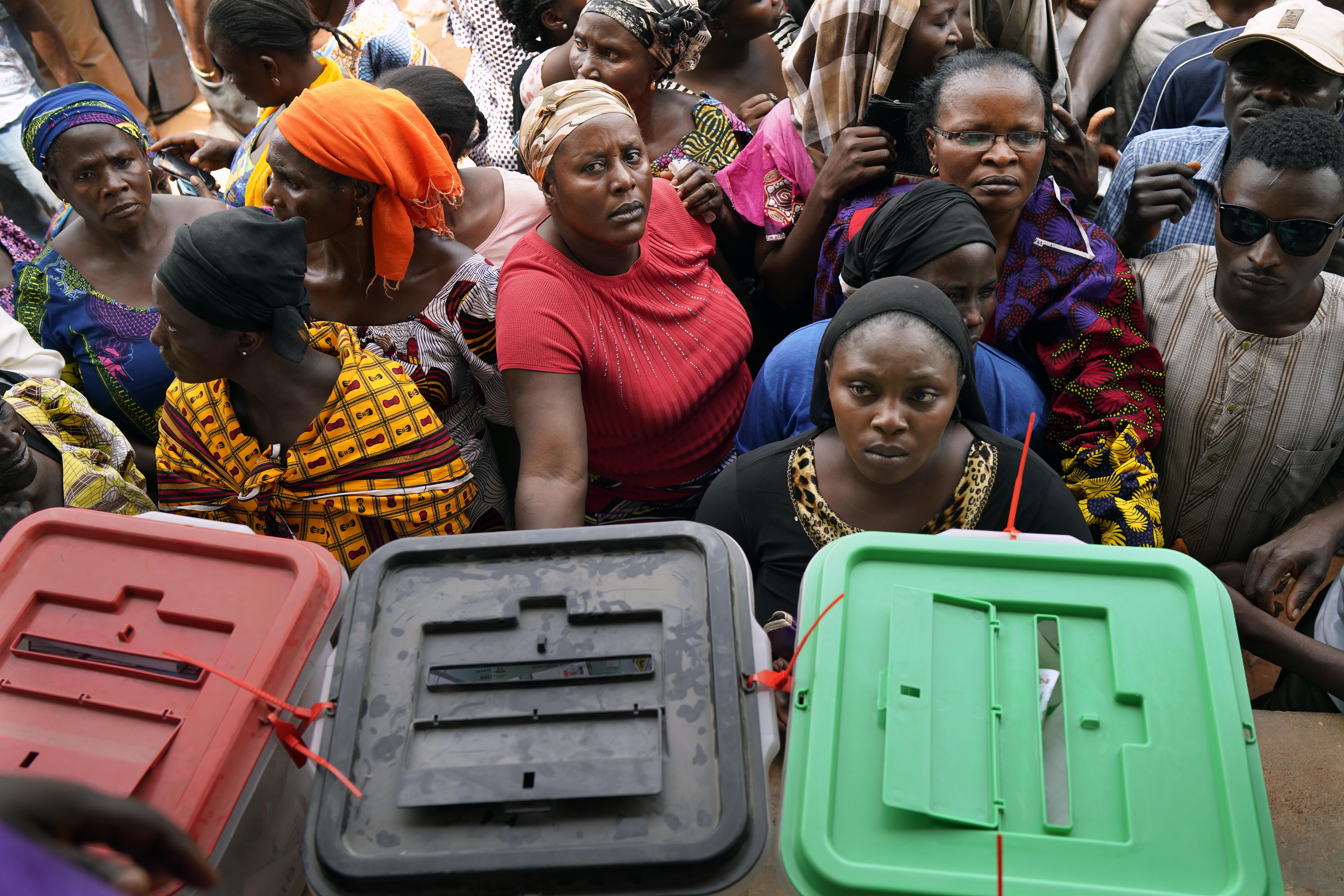 Nigerians line up to vote in Kaduna, Nigeria, Saturday Feb. 23, 2019. The election is widely seen as a tight race between President Muhammadu Buhari and his main rival, former vice president Atiku Abubakar. (AP Photo/Jerome Delay)