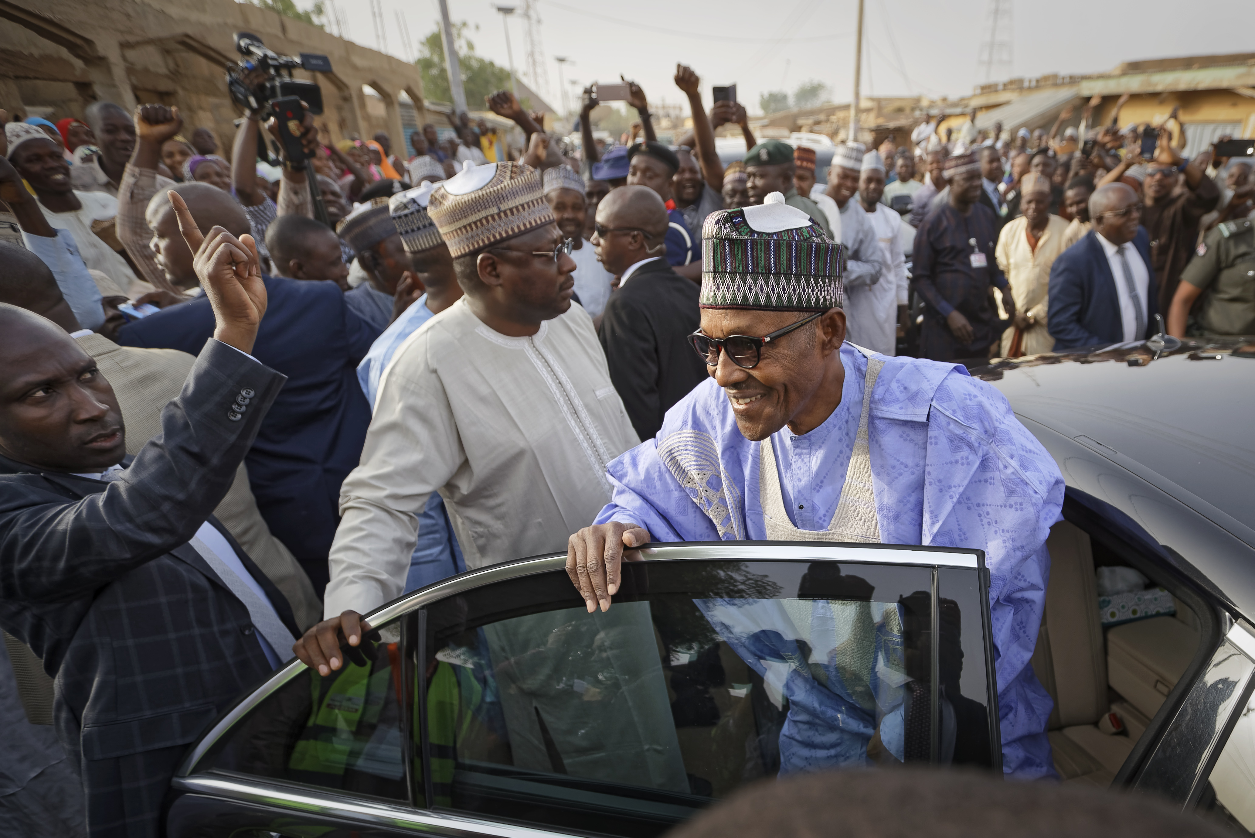 Nigeria's President Muhammadu Buhari leaves after casting his vote in his hometown of Daura, in northern Nigeria Saturday, Feb. 23, 2019. Nigerians are going to the polls for a presidential election Saturday, one week after a surprise delay for Africa's largest democracy. (AP Photo/Ben Curtis)
