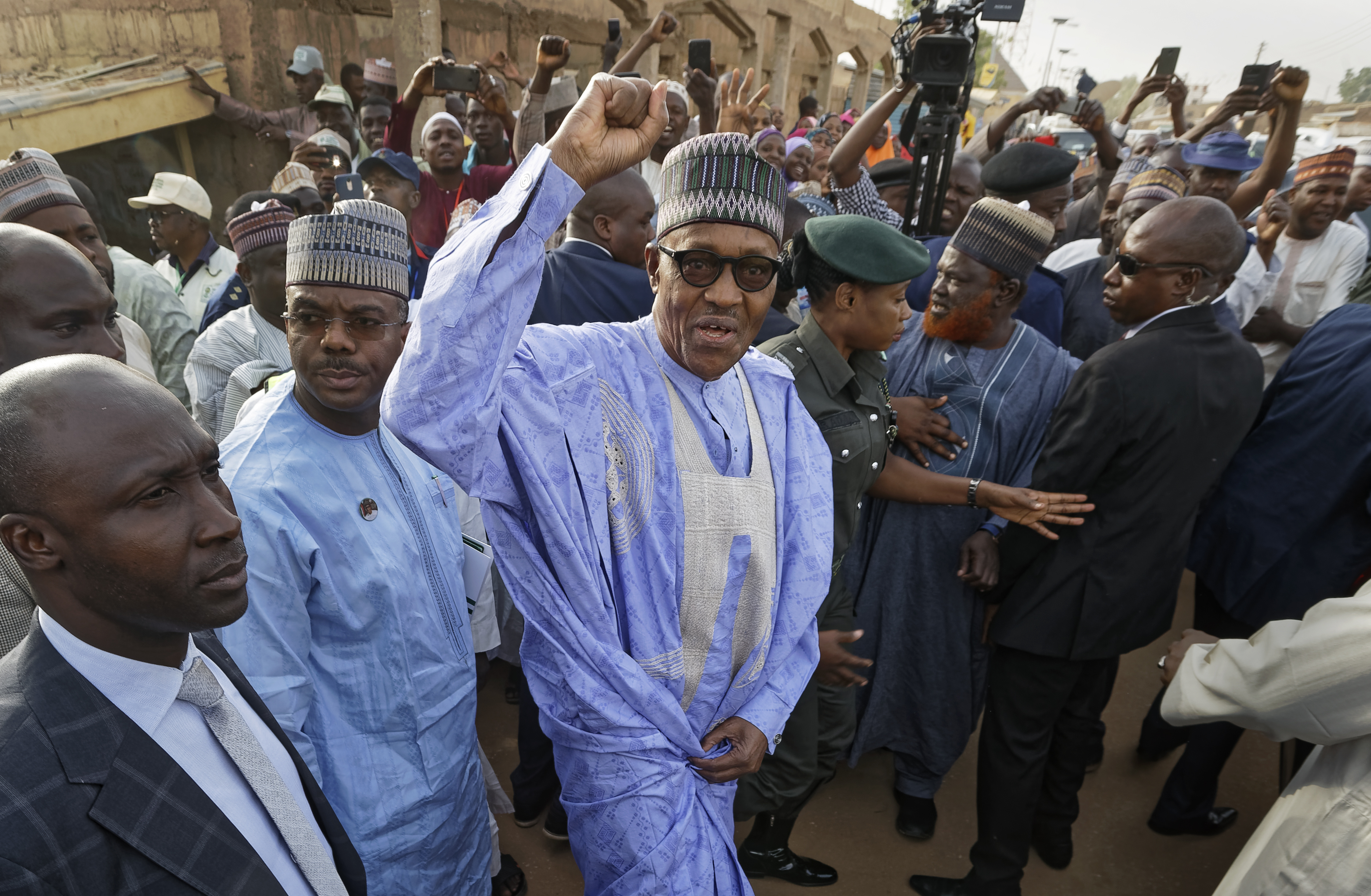 Nigeria's President Muhammadu Buhari gestures to supporters after casting his vote in his hometown of Daura, northern Nigeria, Saturday, Feb. 23, 2019. Nigerians are going to the polls for a presidential election Saturday, one week after a surprise delay for Africa's largest democracy. (AP Photo/Ben Curtis)