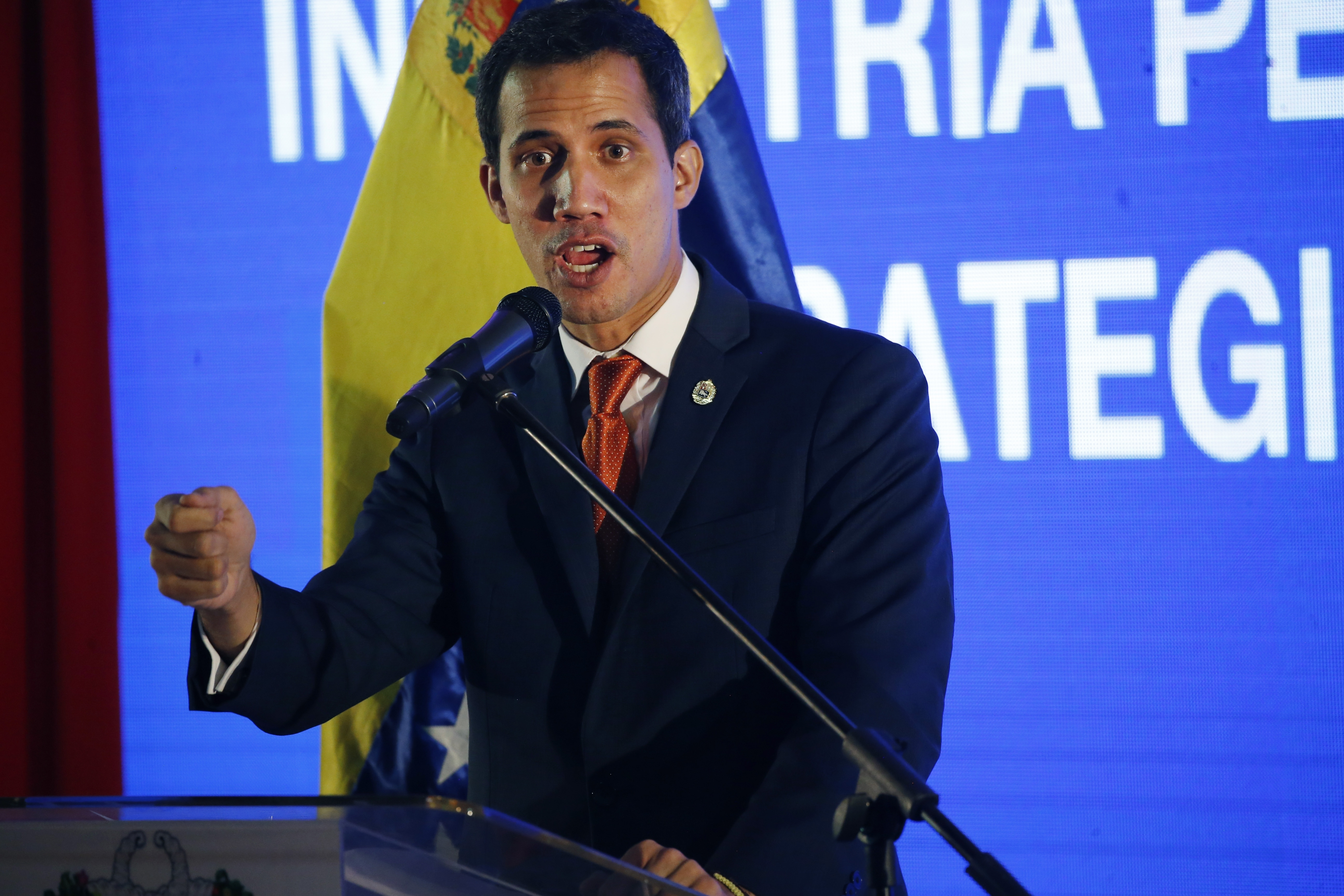 Venezuela's self-proclaimed interim president Juan Guaido, speaks during an economic forum in Caracas, Venezuela, Friday, Feb. 15, 2019. The Trump administration is sending another large shipment of humanitarian aid to the Venezuelan border in Colombia, for the first time using U.S. military aircraft as it increases pressure on Nicolas Maduro to give up power, according to a State Department email sent to Congress. (AP Photo/Ariana Cubillos)