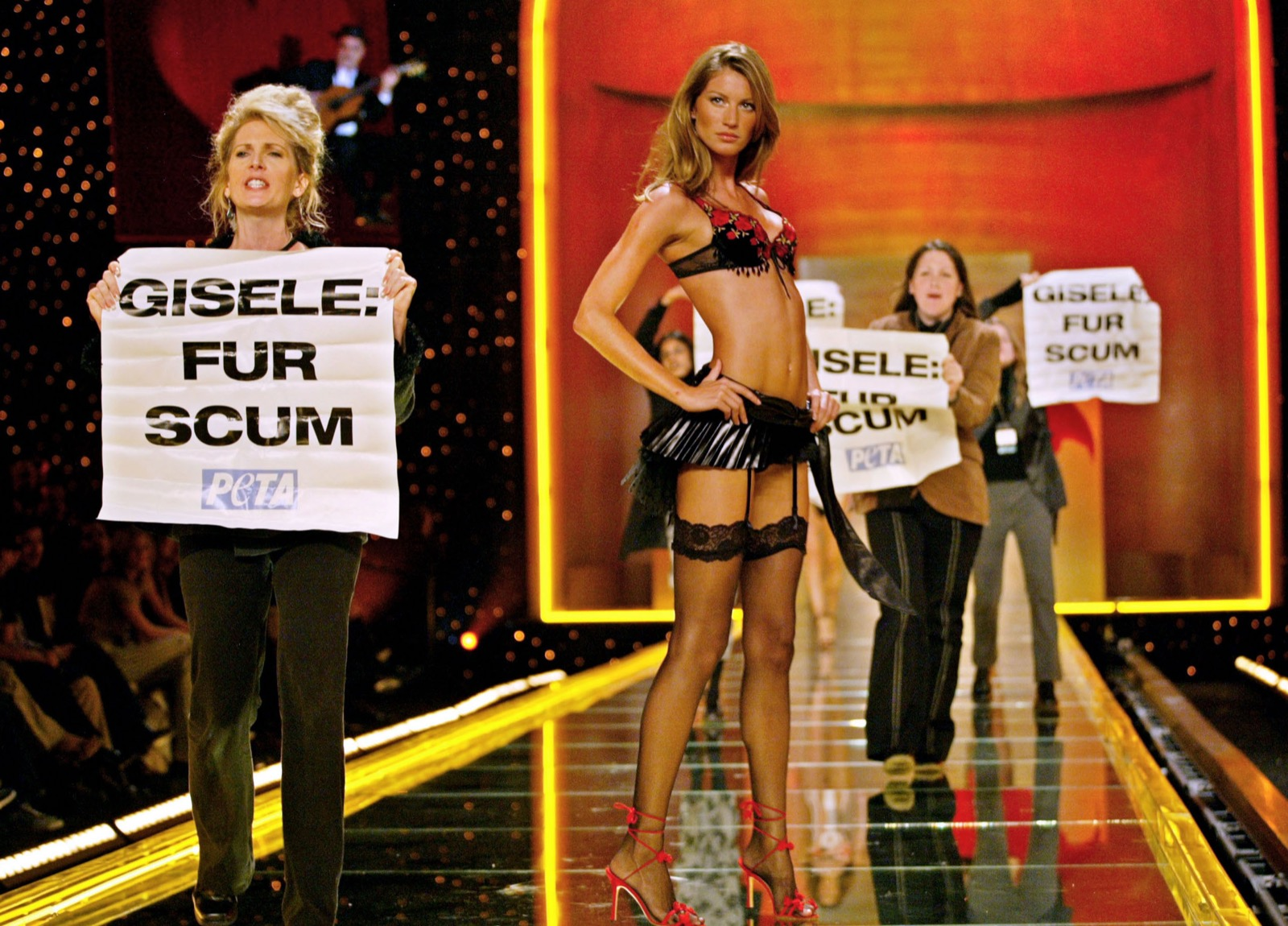 Animal rights activists from PETA rush the stage as supermodel Gisele Bundchen models an outfit during the Victoria's Secret 8th Annual Runway fashion show in New York, November 14, 2002. Timothy C. Clary/AFP/Getty Images