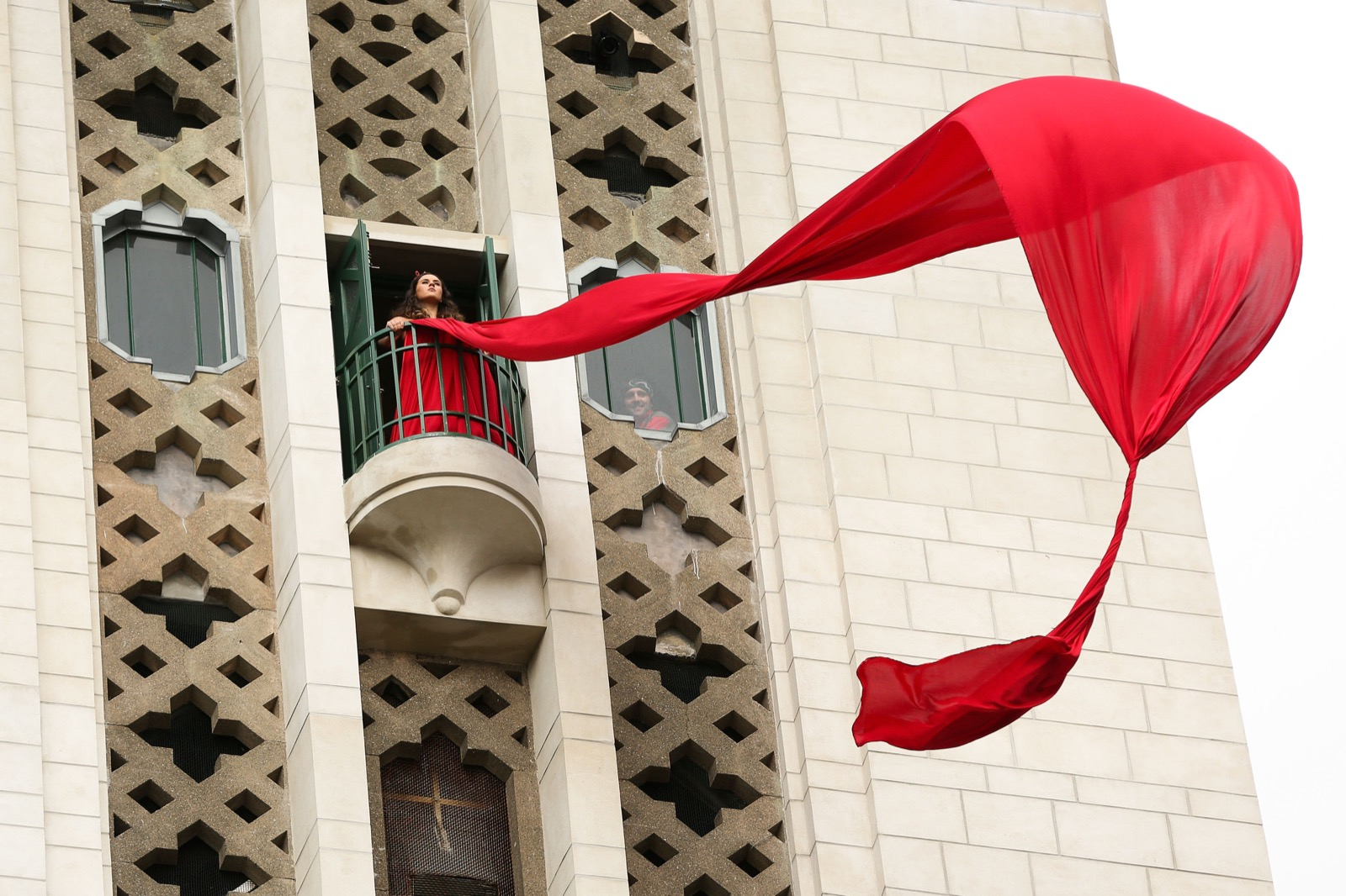 A performer unfurls a red banner from the Carillion during opening of the Pukeahu National War Memorial Park in Wellington, New Zealand. Hagen Hopkins/Getty Images
