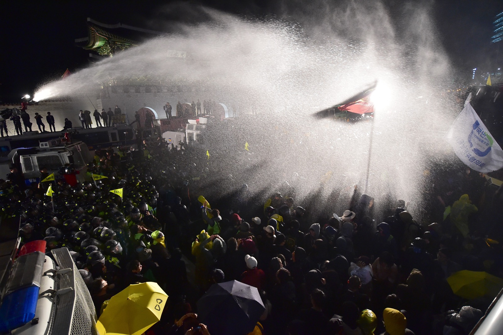 Riot police spray South Korean protestors during a rally in Seoul to mark the first anniversary of the Sewol ferry disaster. JUNG YEON-JE/AFP/Getty Images