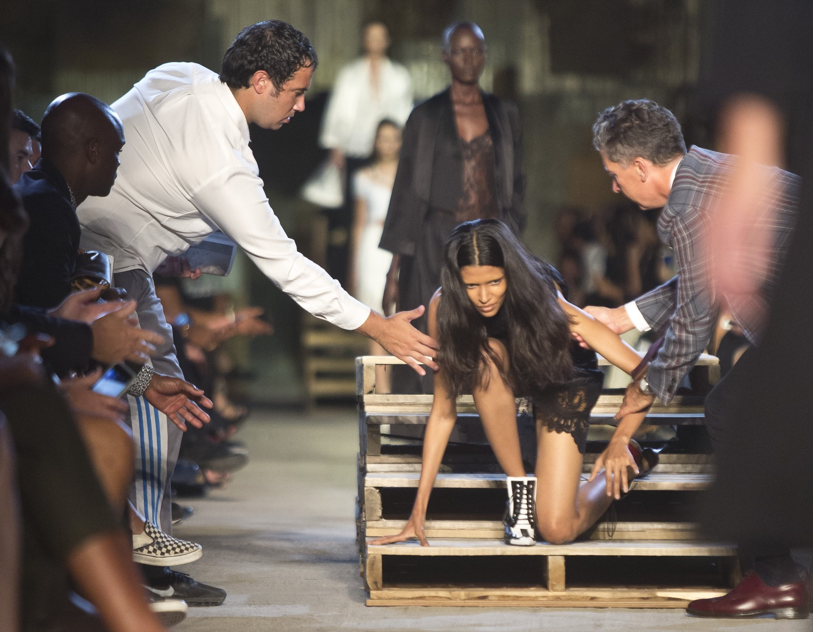 A model falls and gets help back to her feet during the fashion show for the Givenchy Spring 2016 collection. AP Photo/Bebeto Matthews
