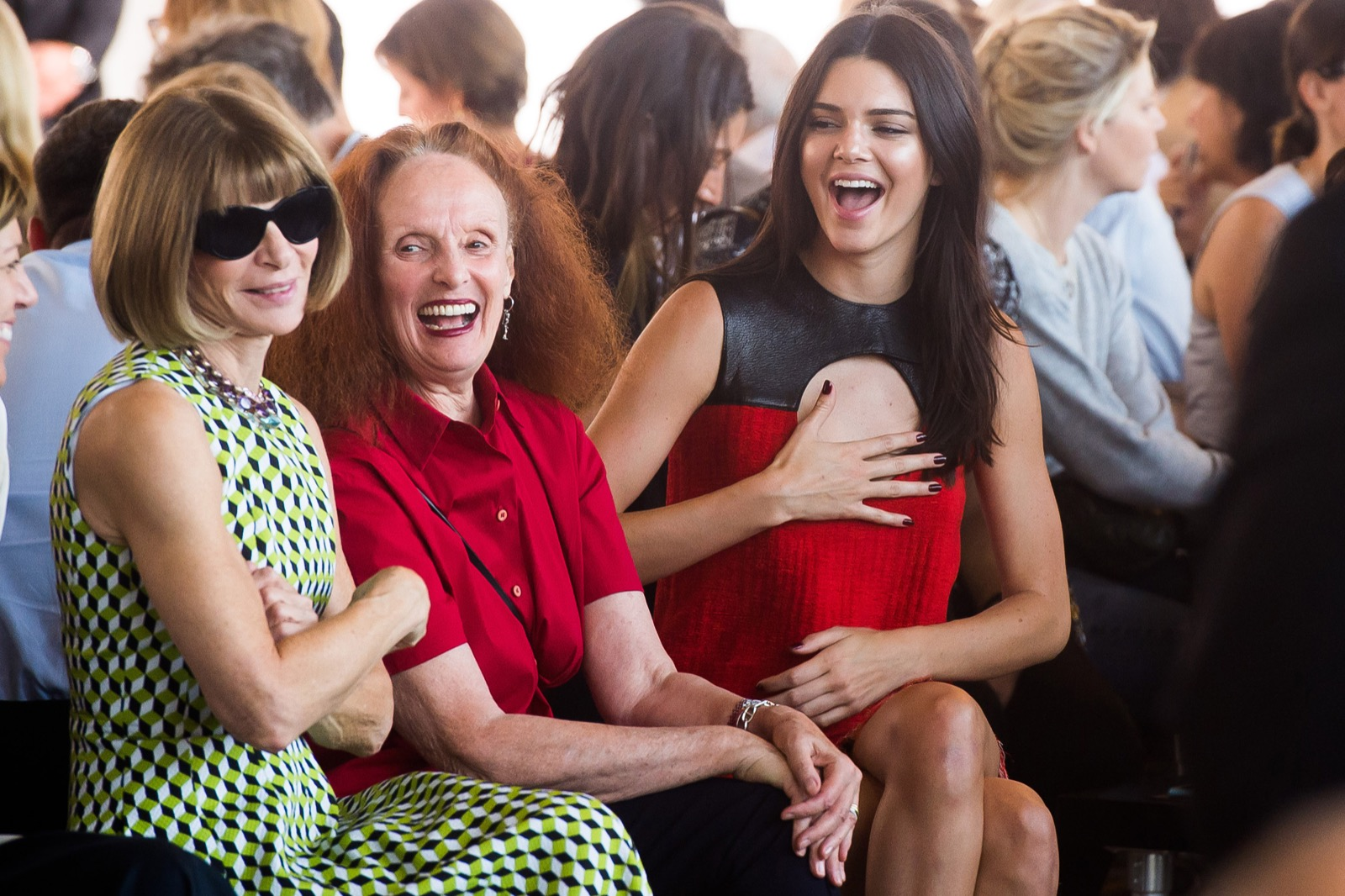 Anna Wintour, Grace Coddington and Kendall Jenner share a light moment while attending the Calvin Klein Spring/Summer 2016 show. Charles Sykes/Invision/AP