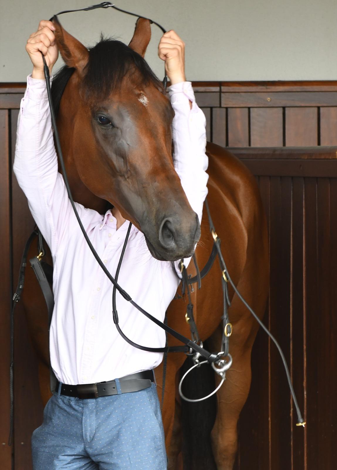 Freddie Lenclud saddles up Oscietra during Melbourne Racing at Flemington Racecourse. Vince Caligiuri/Getty Images