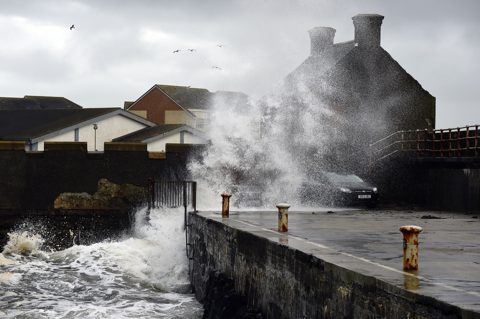 Waves crash as the remnants of Storm Ophelia hit Saltcoats, on the west coast of Scotland. ANDY BUCHANAN/AFP/Getty Images