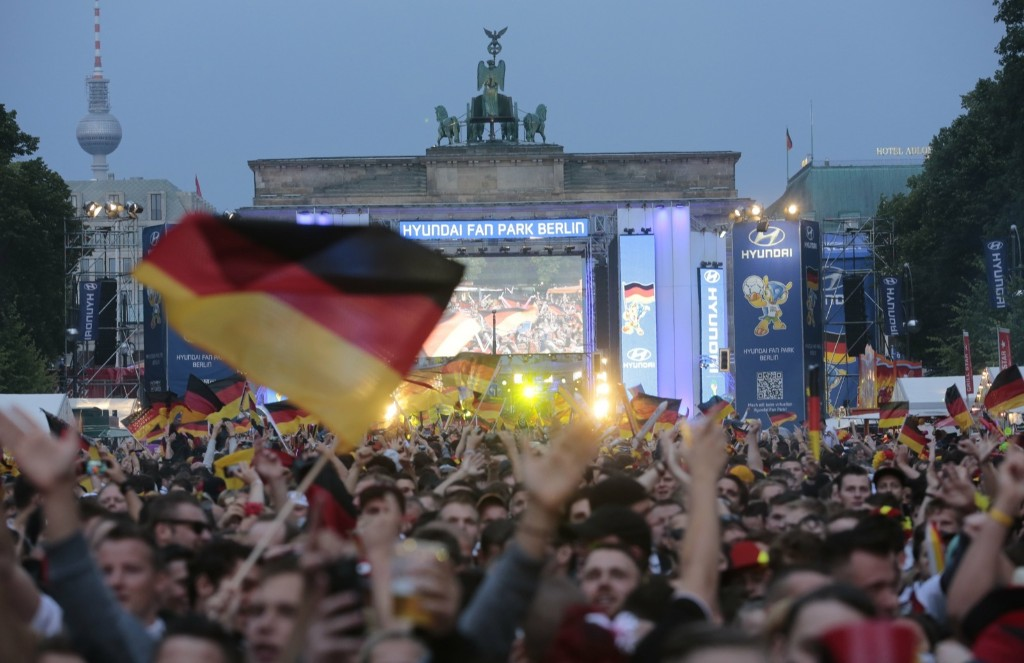 Thousands of German soccer fans watching live telecast in front of the Brandenburg Gate in Berlin. AP Photo/Markus Schreiber