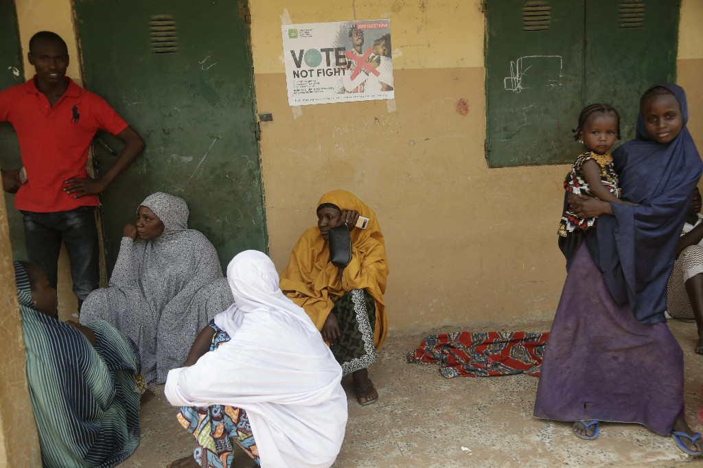 Voters wait to cast their votes during the Presidential and National Assembly election in Damilu Yola, Nigeria, Saturday, Feb. 23, 2019. Africa's most populous country goes to the polls on Saturday to decide whether President Muhammadu Buhari deserves a second term. While more than 70 people are running to lead Nigeria, the close race comes down to Buhari and a billionaire former vice president, Atiku Abubakar. (AP Photo/Sunday Alamba)