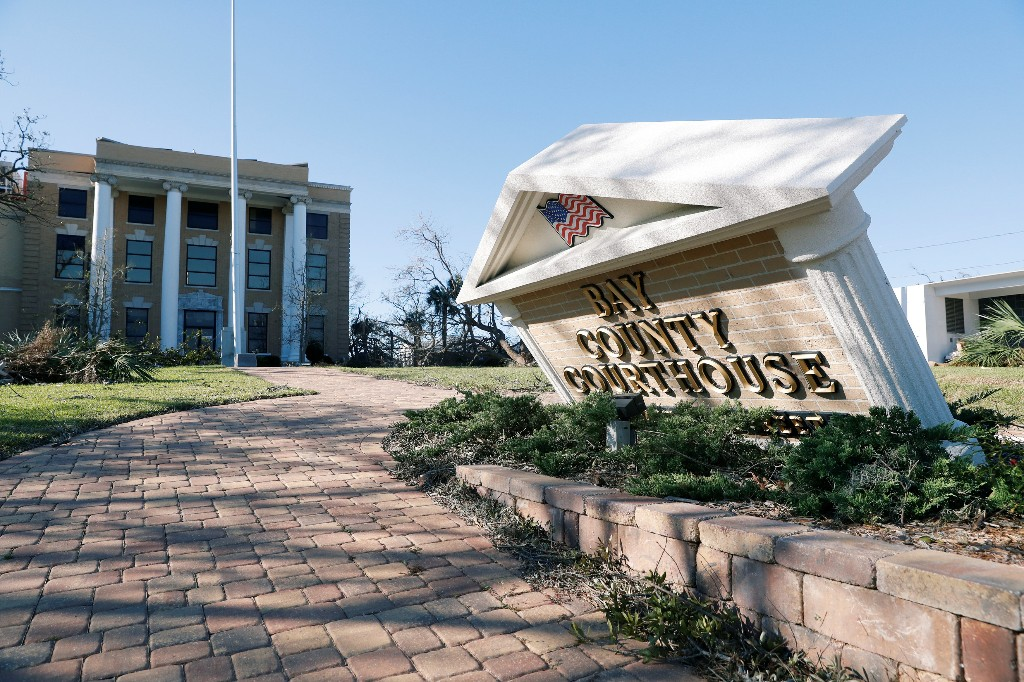 A sign stands askew in the aftermath of Hurricane Michael at the Bay County Courthouse in Panama City, Florida, U.S., October 13, 2018. REUTERS/Terray Sylvester