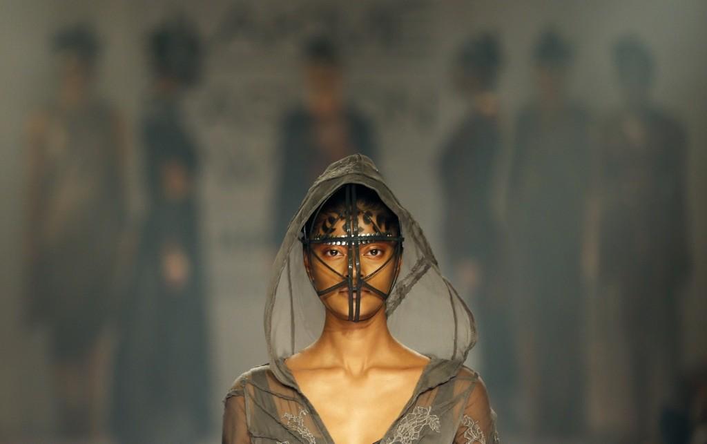 A model displays a creation by a Gen Next designer during the Lakme Fashion Week in Mumbai. AP Photo/Rajanish Kakade