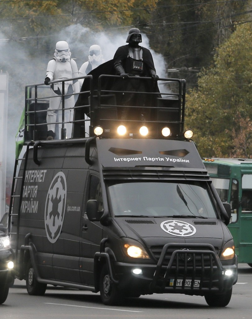 Darth Vader, leader of Ukraine's Internet Party, rides atop a car in Kiev. AP Photo/Efrem Lukatsky