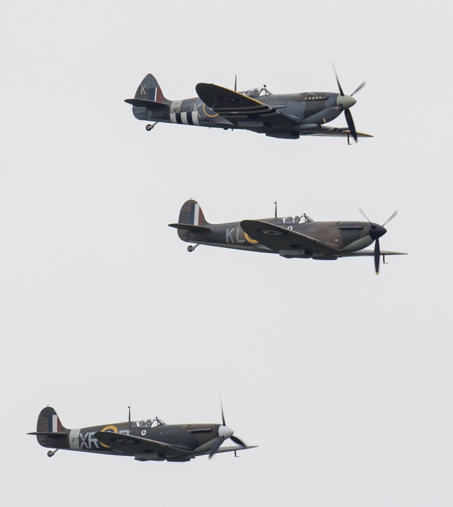 Spitfire and Hurricane planes take part in a Battle of Britain flypast, Tuesday, in Biggin Hill, England. Mark Cuthbert/UK Press/Getty Images