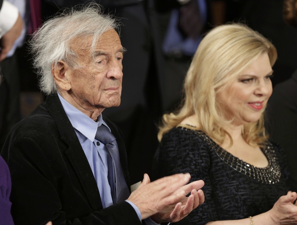 Sara Netanyahu, wife of Israeli Primine Minister Benjamin Netanyahu, aplauds with Holocaust survivor and Nobel Prize winner Elie Wiesel prior to Prime Minister Netanyahu's address to a joint meeting of Congress in Washington, Tuesday. REUTERS/Joshua Roberts