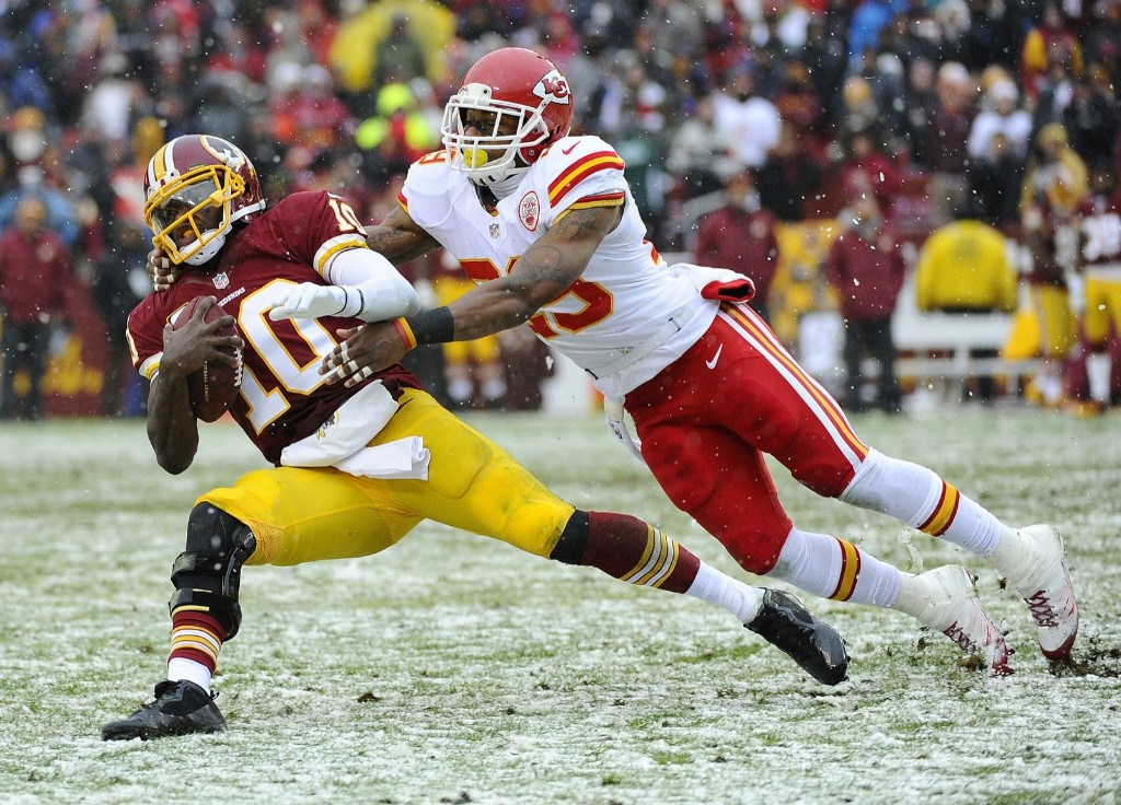Redskins quarterback Robert Griffin III is stopped by safety Eric Berry. Brad Mills-USA TODAY Sports
