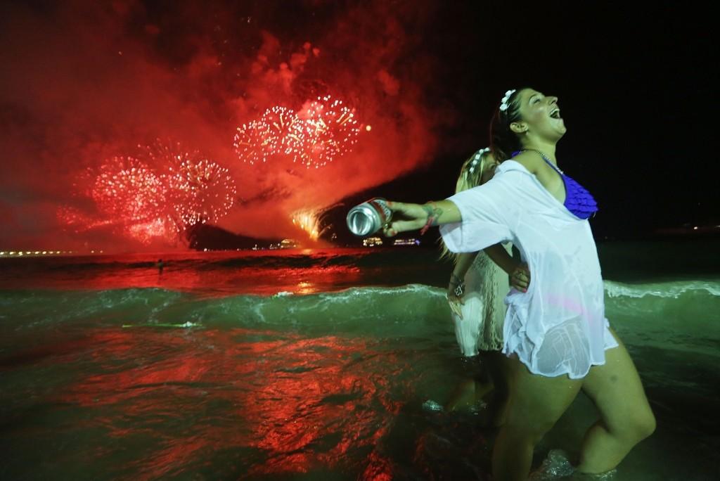Revelers celebrate the start of the New Year on Copacabana beach. Mario Tama/Getty Images