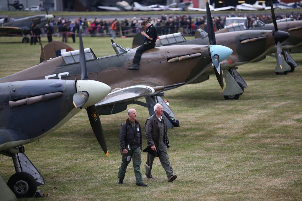 Pilots walk past Hurricanes and Spitfires, Teusday, in Biggin Hill, England. Carl Court/Getty Images