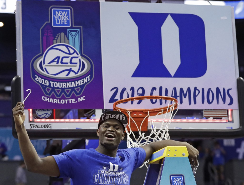 Duke's Zion Williamson celebrates Duke's win over Florida State after cutting a piece of a net after the NCAA college basketball championship game of the Atlantic Coast Conference tournament in Charlotte, N.C., Saturday, March 16, 2019. (AP Photo/Nell Redmond)