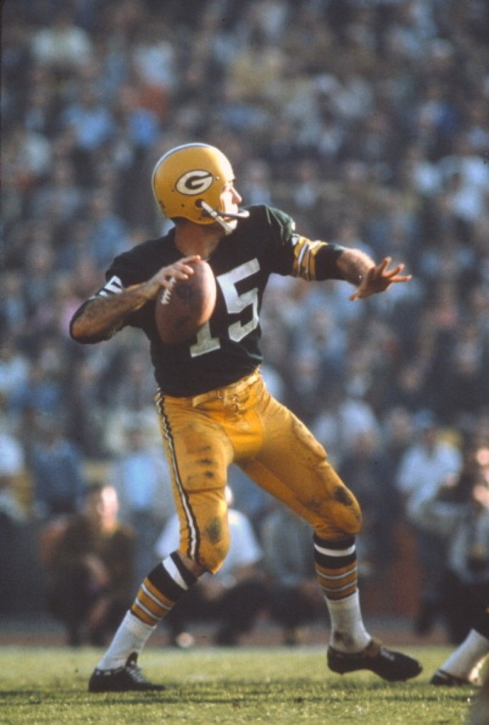 Bart Starr of the Packers drops back to pass against the Chiefs during NFL/AFL title game, Jan. 1967 at the Los Angeles Coliseum. The Packers won, 35-10. Focus on Sport/Getty Images