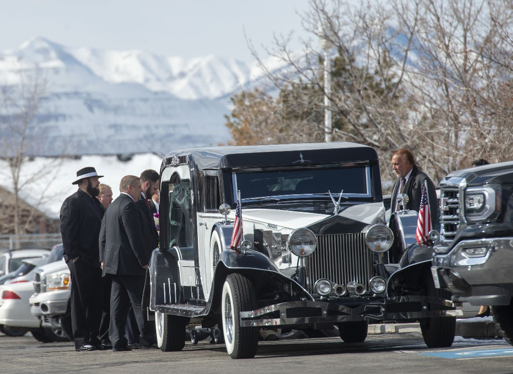 The hearse awaits Laurie Holt's casket at the Summerhill Stake Center after the funeral Saturday, Feb. 16, 2019, in Riverton, Utah. Holt died unexpectedly Feb. 10 at her Riverton, Utah, home, less than one year after her son Josh Holt returned to the U.S. after being imprisoned for nearly two years on weapons charges that the Holts and U.S. politicians said were invented. Her husband, Jason Holt, says she died peacefully but the family has not said what caused her death. (Rick Egan/The Salt Lake Tribune via AP)