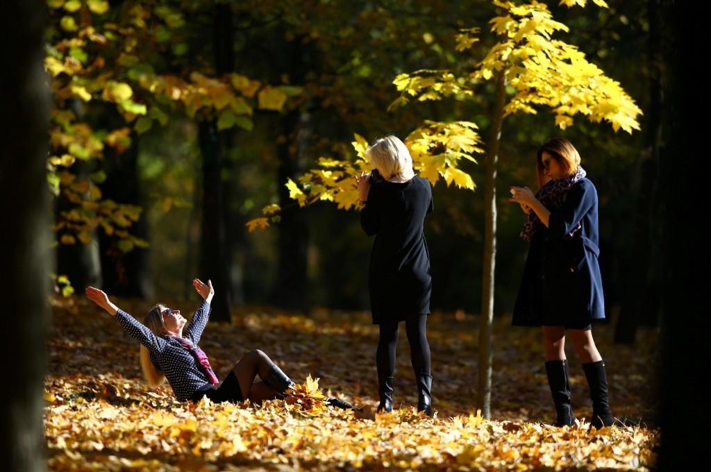 Women enjoy an autumn day in Minsk. REUTERS/Vasily Fedosenko