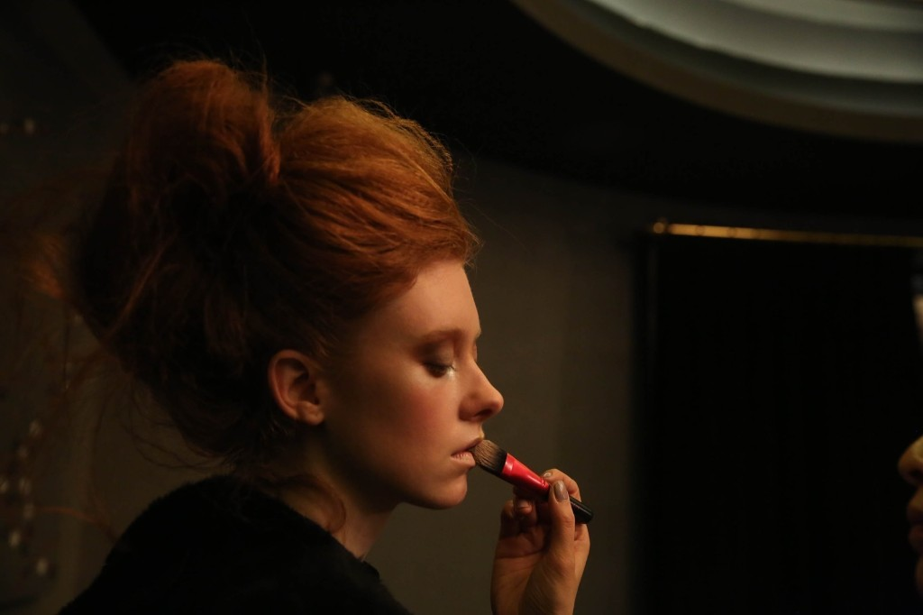 A model prepares backstage before presenting the Big Park Fall/Winter 2015 collection during New York Fashion Week, Thursday. Rob Kim/Getty Images