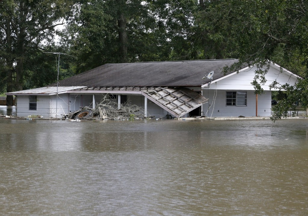 A flooded home in St. Amant, La. REUTERS/Jonathan Bachman