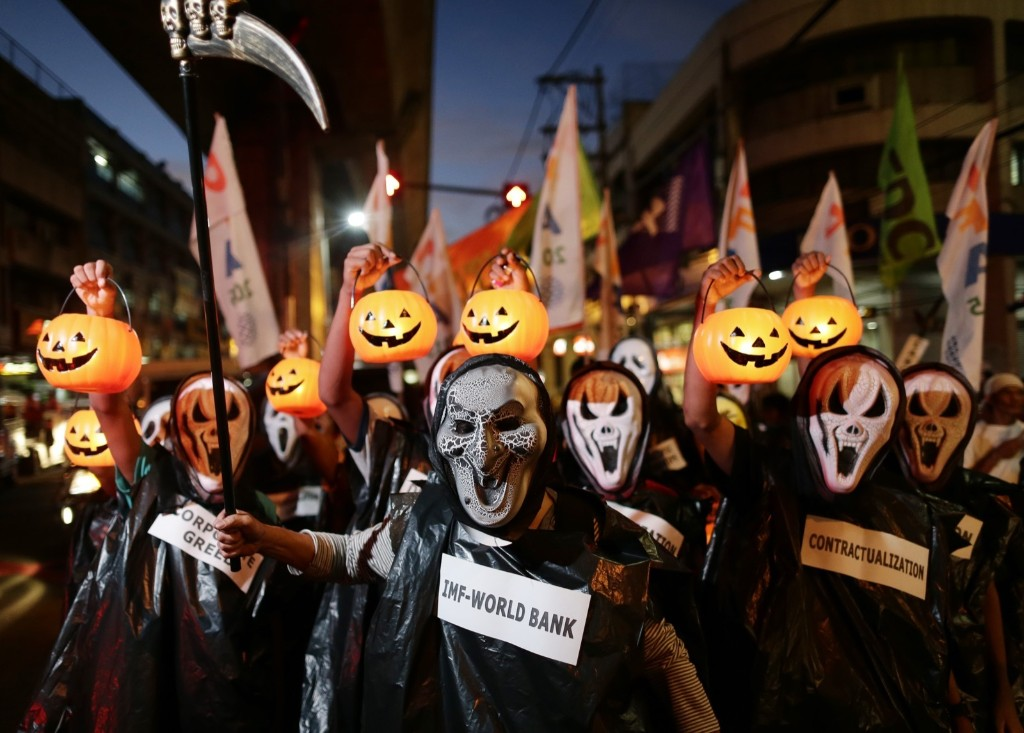 Filipino activists wearing Halloween-themed masks stage a protest in Manila. EPA/FRANCIS R. MALASIG