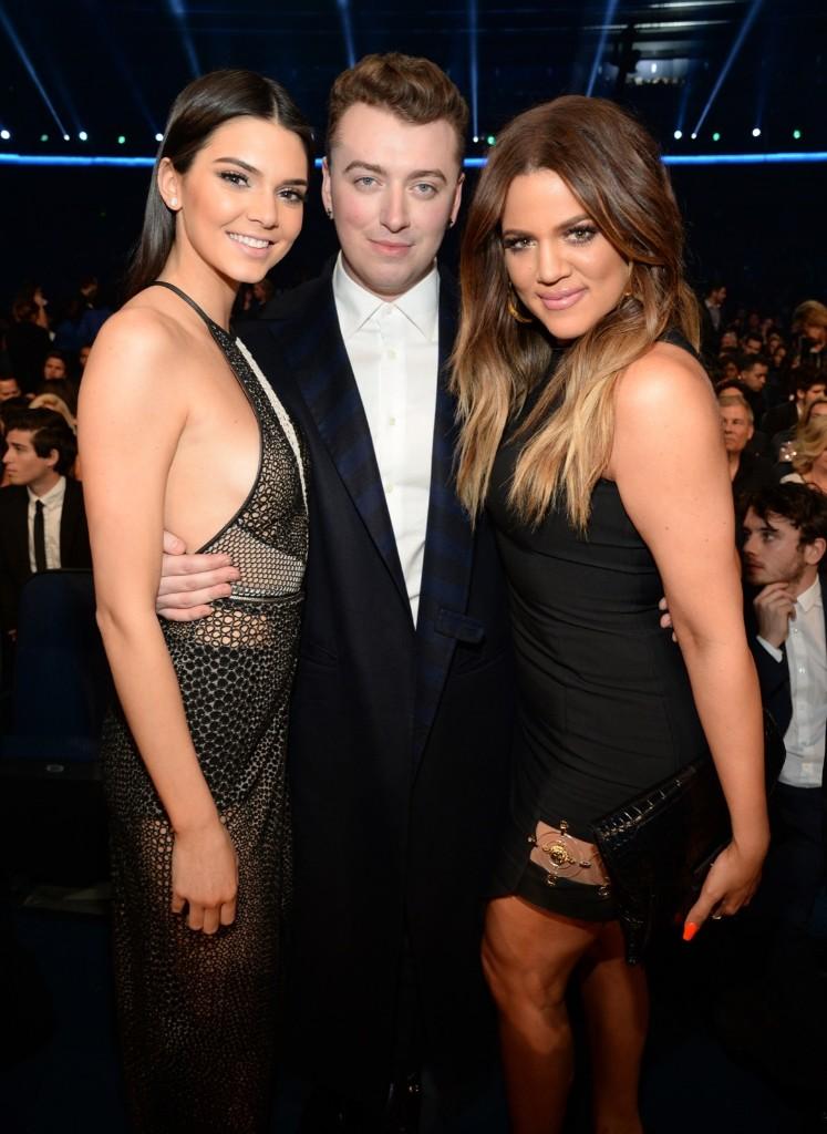 Kendall Jenner, Sam Smith and Khloe Kardashian at the AMAs. Kevin Mazur/AMA2014/WireImage