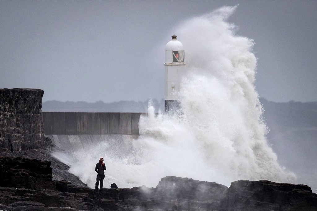 Waves whipped up by Storm Helene hit the seafront in Porthcawl, Wales. Matt Cardy/Getty Images