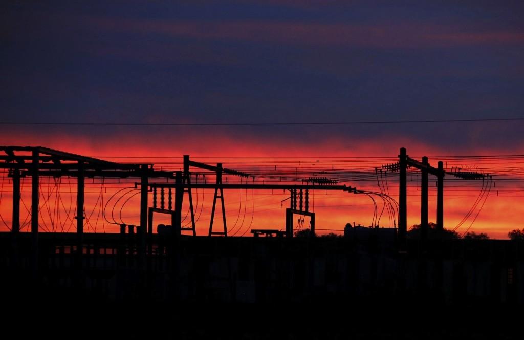 High-tension electrical power pylons at sunrise in Puisseguin, southwestern France. REUTERS/Regis Duvignau