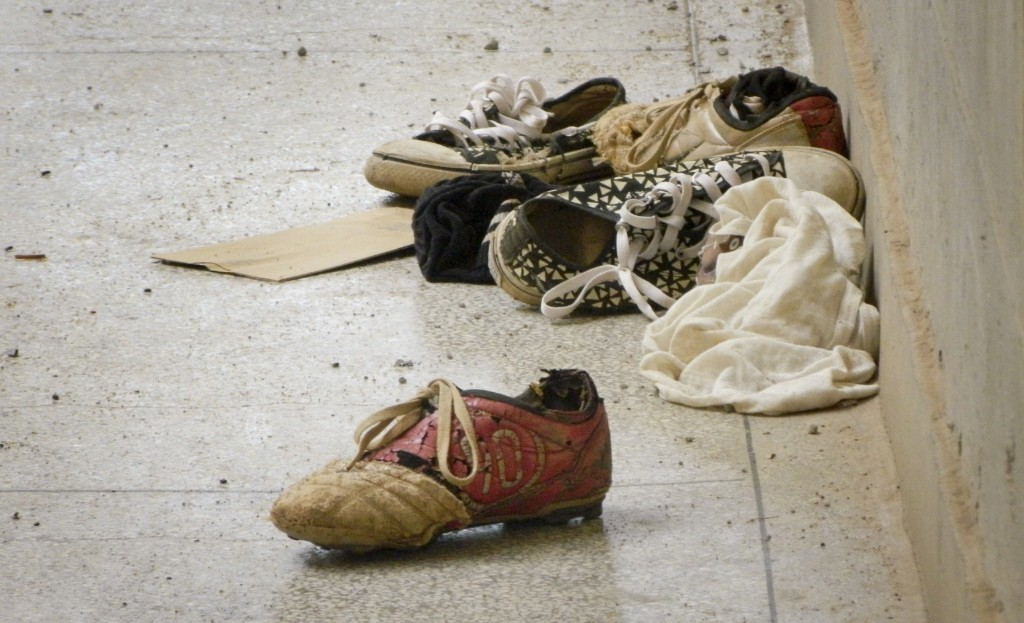 Abandoned shoes lie next to the Elgon A hostel inside the Garissa University College compound that was the scene of last week's attack by al-Shabab gunmen. AP Photo