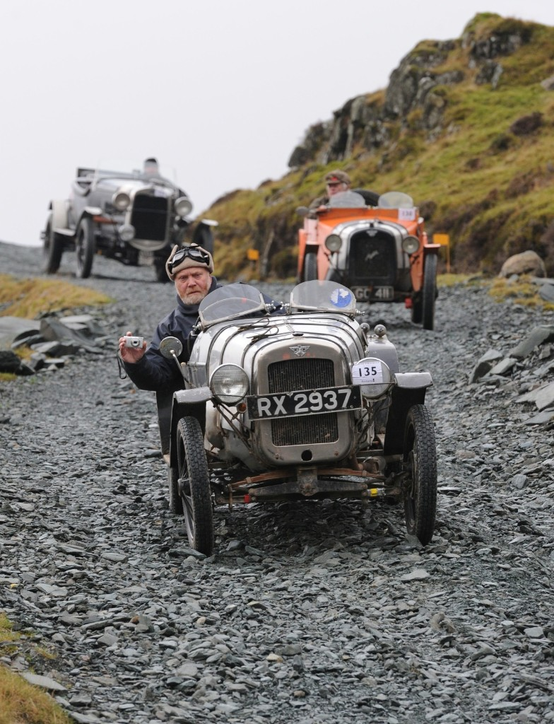 Competitors during a vintage car rally stage at the Honister Slate Mine in the Lake District, England. Anna Gowthorpe/Getty Images