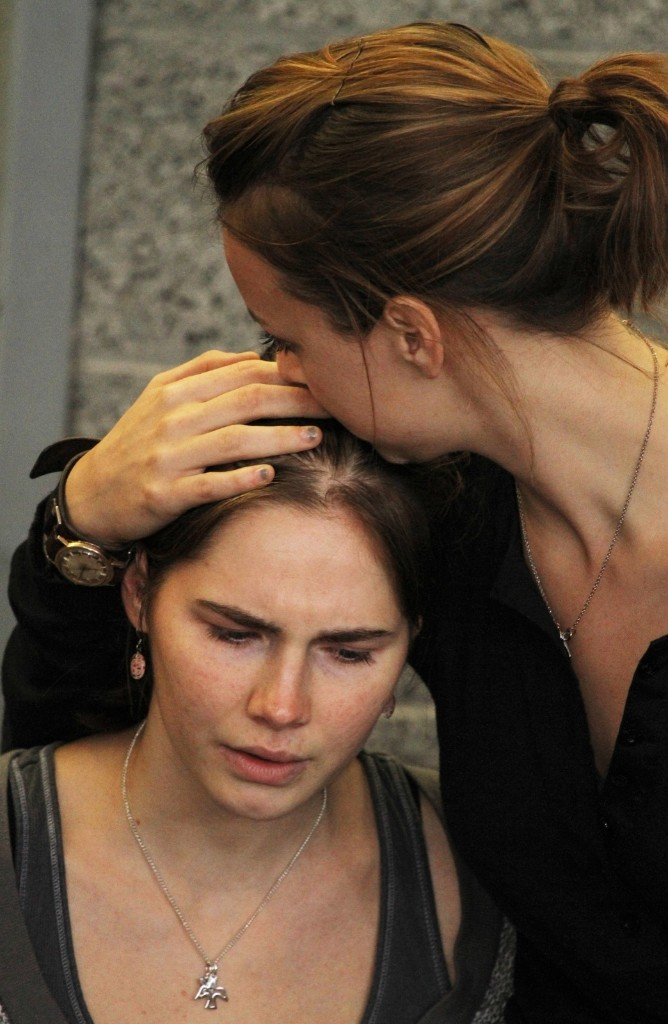 Amanda Knox is comforted by her sister, Deanna Knox, after her arrival at Seattle-Tacoma International Airport, Oct. 4, 2011. Kevin Casey/AFP/Getty Images