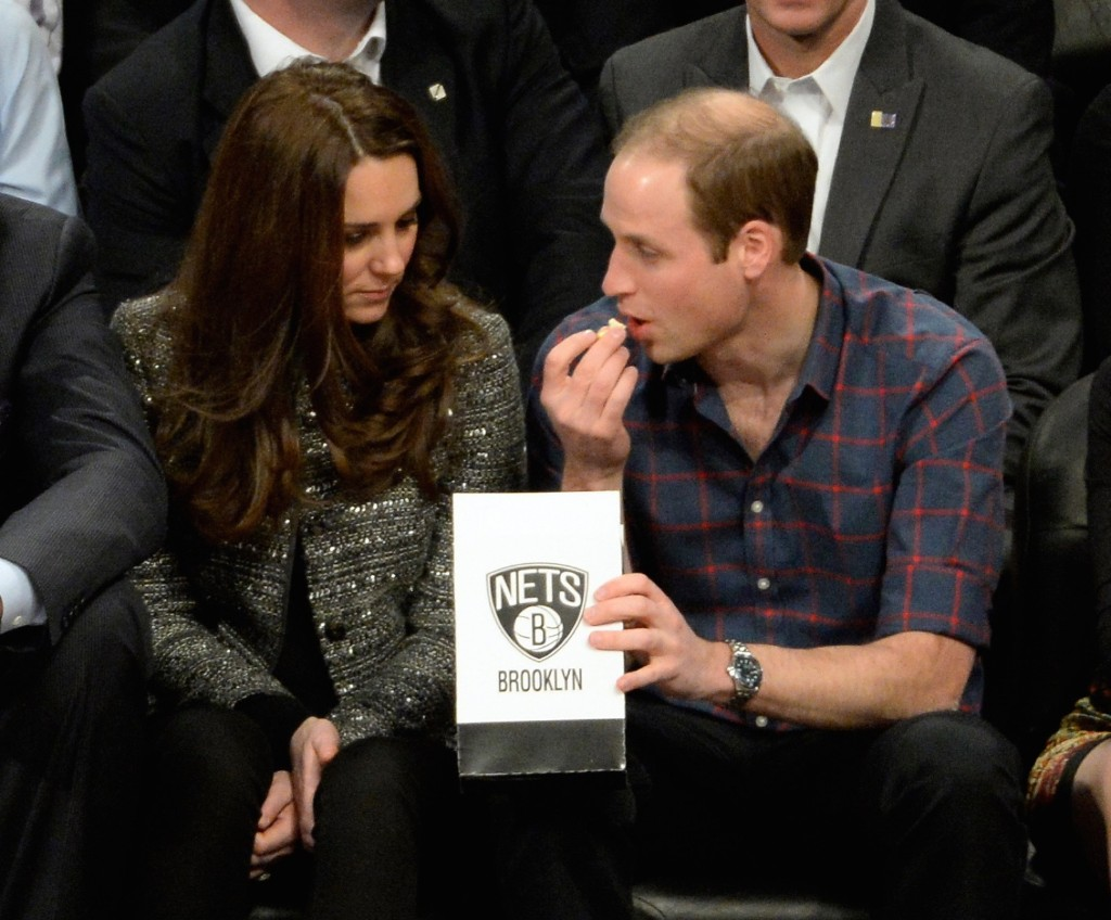 Prince William, Duke of Cambridge and Kate, Duchess of Cambridge having popcorn while attending the NBA game between the Brooklyn Nets and the Cleveland Cavaliers in New York, Monday. Robert Deutsch/USA TODAY Sports