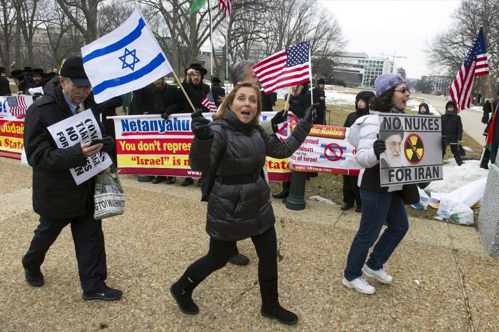 Pro Israel demonstrators walks past anti-Israel demonstrators on Capitol Hill in Washington, Tuesday. AP Photo/Cliff Owen