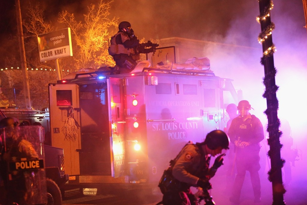 Police confront protestors after rioting broke out in Ferguson. Scott Olson/Getty Images