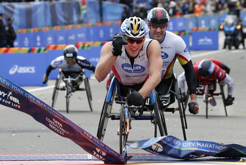 Kurt Fearnley of Australia winning the mens wheelchair division. AP Photo/Kathy Willens