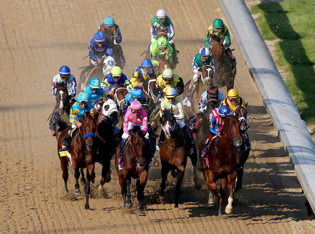 The field tightens after the start of the 141st running of the Kentucky Derby, at Churchill Downs, Saturday, in Louisville. Elsa/Getty Images