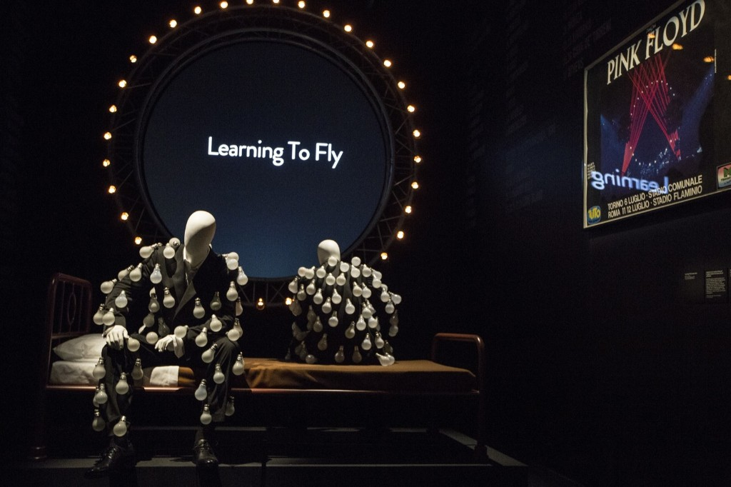 Mannequins in 'a lightbulb suit' in front of a 'Learning to Fly' display. Joel Ryan/Invision/AP