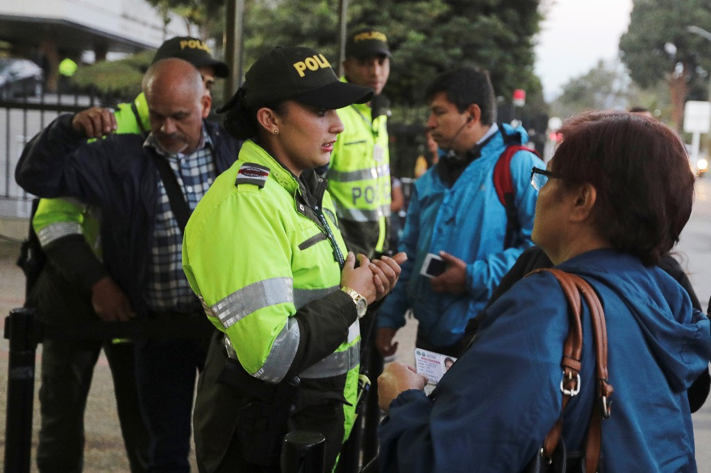 Police officers stand guard at the entrance of one of the hospitals where victims of a car bomb explosion are being treated, according to authorities, in Bogota, Colombia January 17, 2019. REUTERS/Luisa Gonzalez