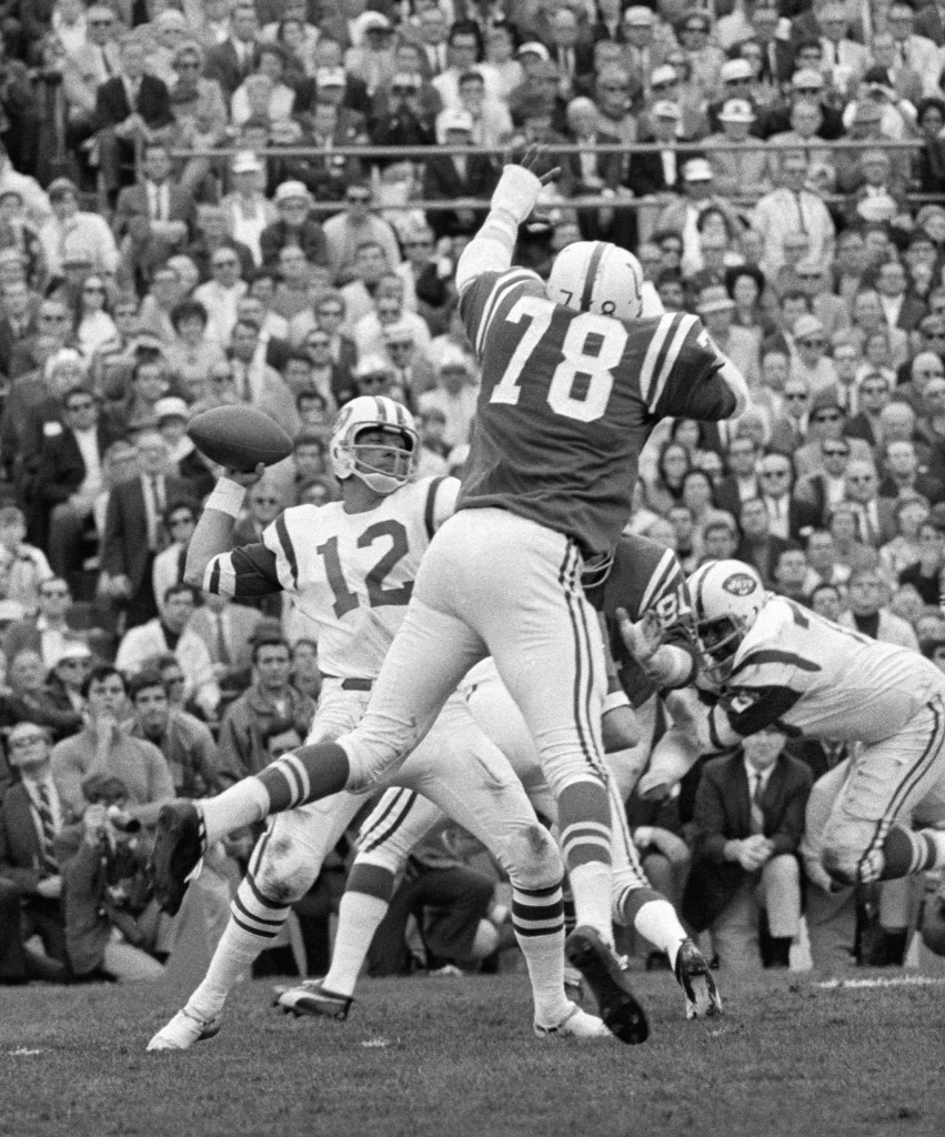 Bubba Smith of the Colts leaps in a vain attempt to block a pass from Jets quarterback Joe Namath during Super Bowl III in Miami, Jan. 1969. Namath led the Jets to a 16-7 win, still considered one of the biggest upsets in American sports. AP Photo
