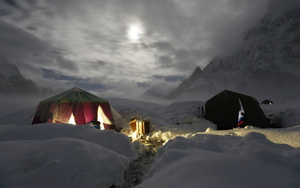 The moon illuminates the snow-covered Concordia, formed by the confluence of the Baltoro and Godwin-Austen glaciers, near K2 in Pakistan. REUTERS/Wolfgang Rattay
