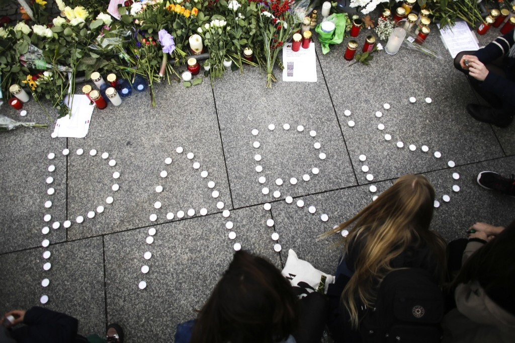 Candles in front of the French Embassy in Berlin. AP Photo/Markus Schreiber
