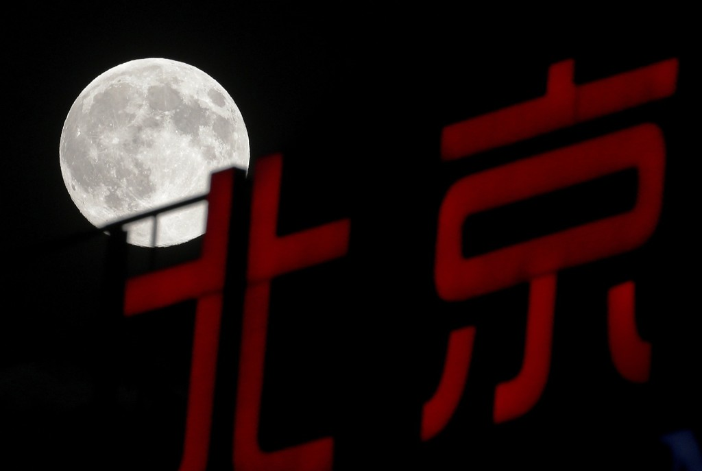 Supermoon rises over Chinese calligraphy in Beijing. AP Photo/Andy Wong