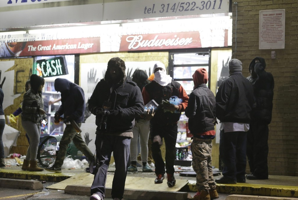 Ferguson Market and Liquor store is vandalized after the announcement of the grand jury decision. AP Photo/Jeff Roberson