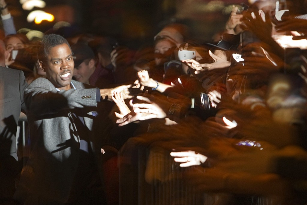 """Chris Rock arrives at the premiere of the film """"Top Five"""" during the Toronto International Film Festival. REUTERS/Fred Thornhill"""