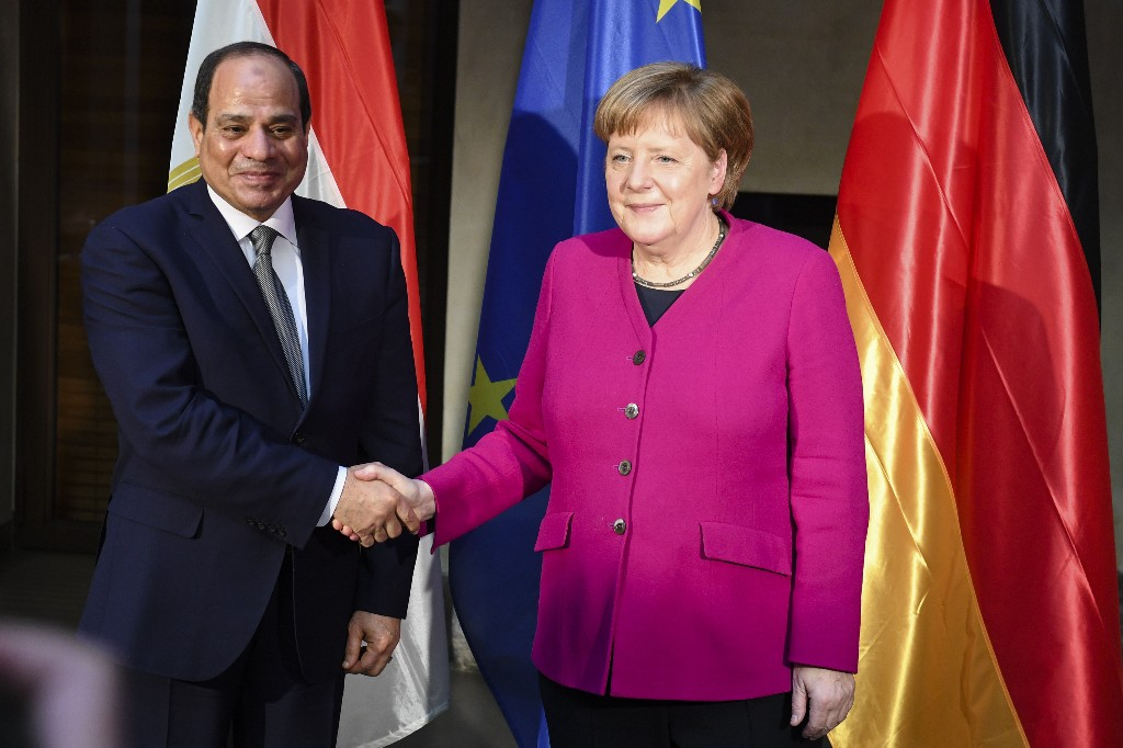 German Chancellor Angela Merkel, right, welcomes the President of Egypt Abdel Fattah al-Sisi, left, for a bilateral meeting during the Munich Security Conference in Munich, Germany, Saturday, Feb. 16, 2019. (AP Photo/Kerstin Joensson)