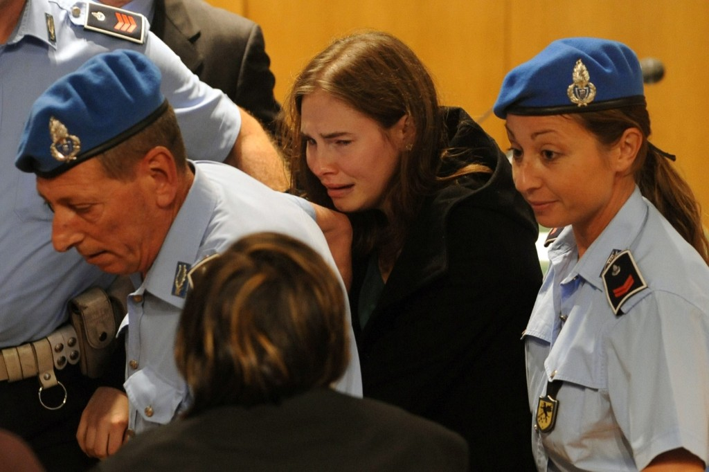 Amanda Knox breaks down in tears after hearing the verdict that overturns her conviction and acquits her of murdering her British roommate Meredith Kercher. Tiziana Fabi/Pool/Getty Images